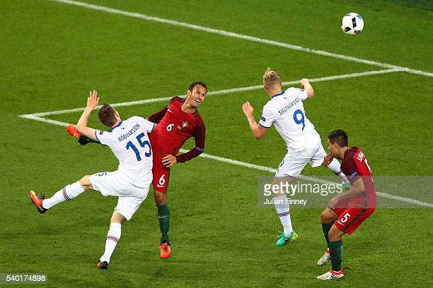 Kolbeinn Sigthorsson Jon Dadi Bodvarsson of Iceland and Ricardo Carvalho and Raphael Guerreiro of Portugal compete for the ball during the UEFA EURO...