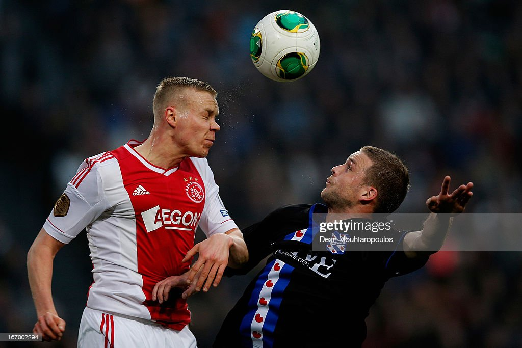 Kolbeinn Sigthorsson of Ajax and Jeffrey Gouweleeuw of Heerenveen battle for the header during the Eredivisie match between Ajax Amsterdam and SC Heerenveen at Amsterdam Arena on April 19, 2013 in Amsterdam, Netherlands.