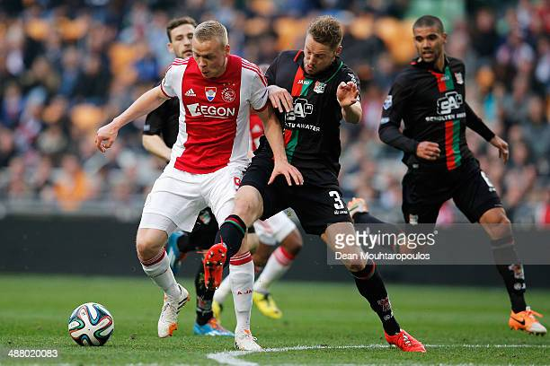 Kolbeinn Sigthorsson of Ajax and Rens Van Eijden of NEC battle for the ball during the Eredivisie match between Ajax Amsterdam and NEC Nijmegen at...