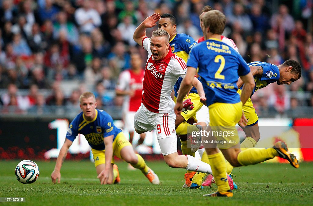 Kolbeinn Sigthorsson of Ajax falls under the tackle but no fouls is given during the Eredivisie match between Ajax Amsterdam and SC Cambuur Leeuwarden at Amsterdam Arena on March 9, 2014 in Amsterdam, Netherlands.