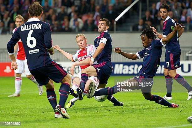 Kolbeinn Sigthorsson of AjaxAnthony Reveillere of Olympique LyonBakary Kone of Olympique Lyon during the Champions League match between Ajax and...