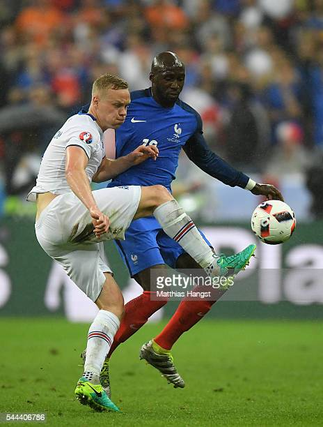 Kolbeinn Sigthorsson of Iceland and Eliaquim Mangala of France compete for the ball during the UEFA EURO 2016 quarter final match between France and...