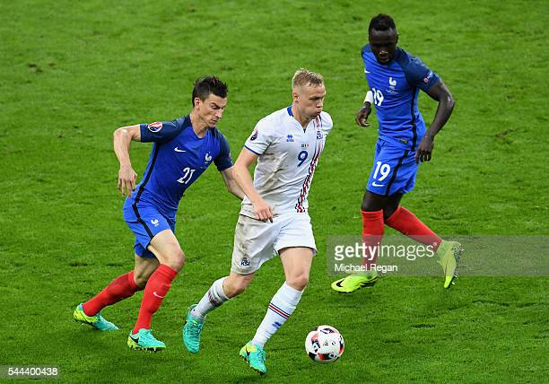 Kolbeinn Sigthorsson of Iceland and Laurent Koscielny of France compete for the ball during the UEFA EURO 2016 quarter final match between France and...
