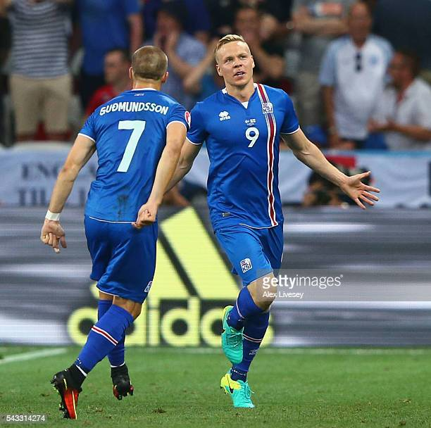 Kolbeinn Sigthorsson of Iceland celebrates scoring his team's second goal with his team mate Johann Gudmundsson during the UEFA EURO 2016 round of 16...