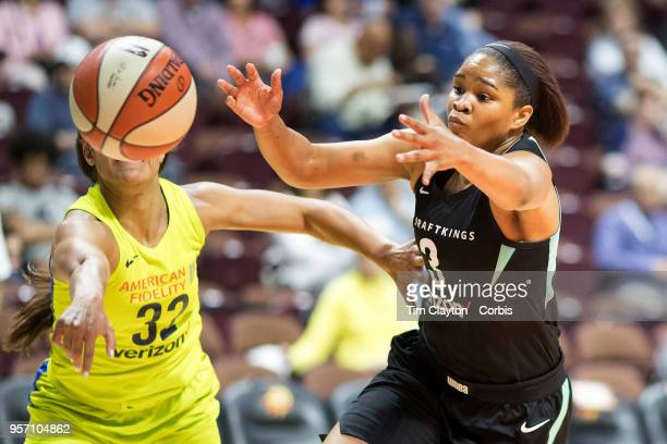 Kolby Morgan of the New York Liberty rebounds while challenged by Loryn Goodwin of the Dallas Wings during the Dallas Wings Vs New York Liberty WNBA...