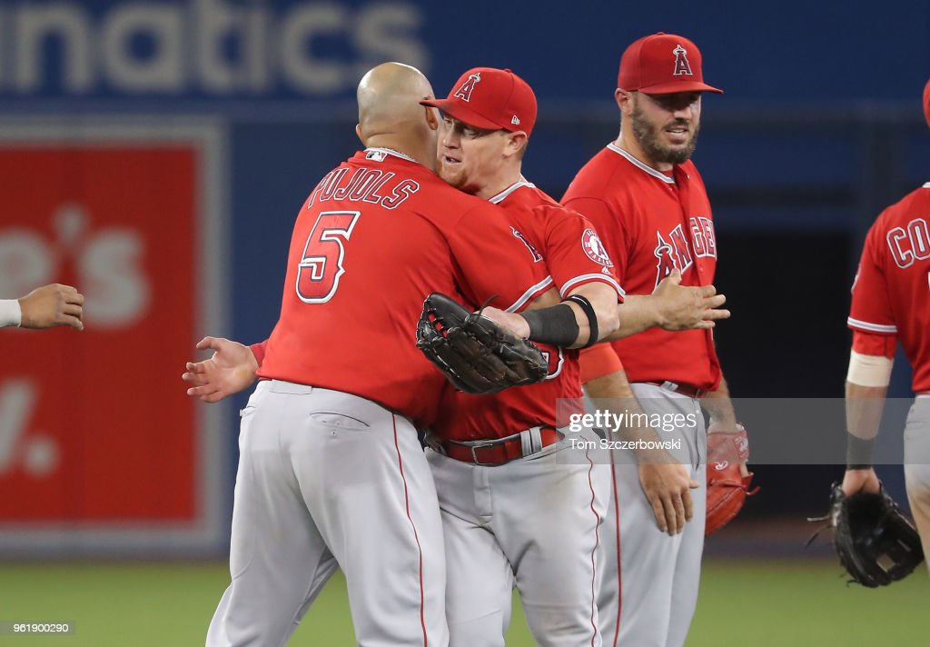 Kole Calhoun #56 and Albert Pujols #5 of the Los Angeles Angels of Anaheim celebrate a victory over the Toronto Blue Jays at Rogers Centre on May 23, 2018 in Toronto, Canada.