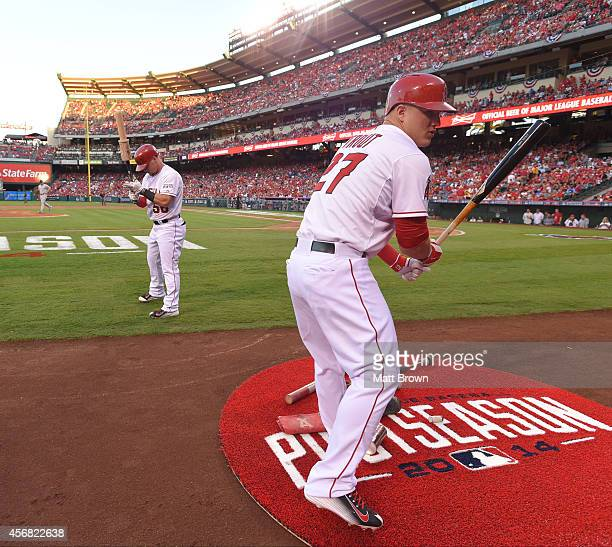 Kole Calhoun and Mike Trout of the Los Angeles Angels of Anaheim warm up in the on deck circle during the game against the Kansas City Royals during...