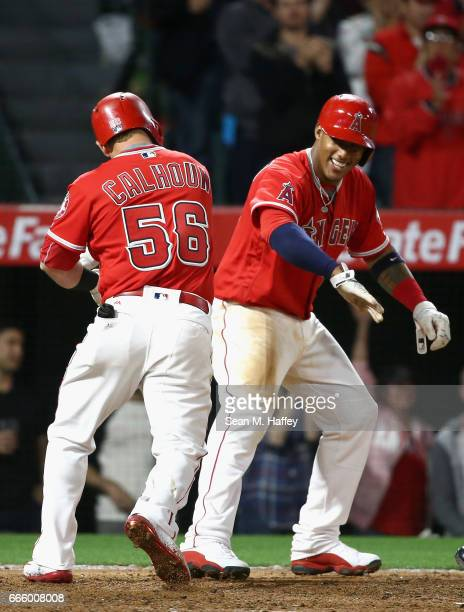 Kole Calhoun is congratulated by Yunel Escobar of the Los Angeles Angels of Anaheim after hitting a tworun homerun during the seventh inning of the...
