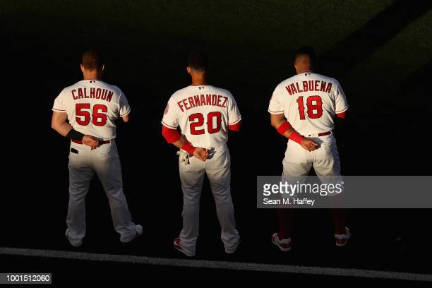 Kole Calhoun Jose Fernandez and Luis Valbuena of the Los Angeles Angels of Anaheim stand for the national anthem prior to a game against the Arizona...