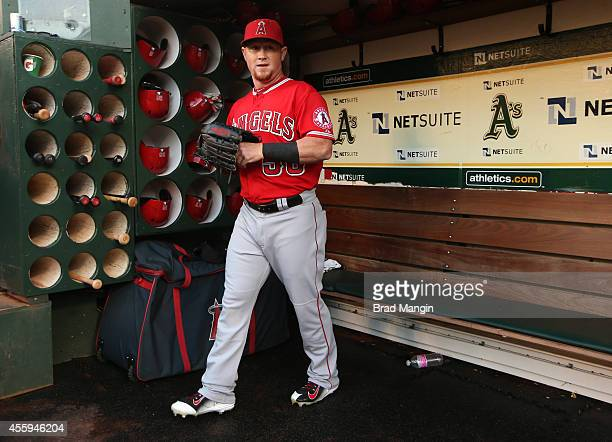 Kole Calhoun of the Los Angeles Angels gets ready in the dugout before the game against the Oakland Athletics at Oco Coliseum on Monday September 22...