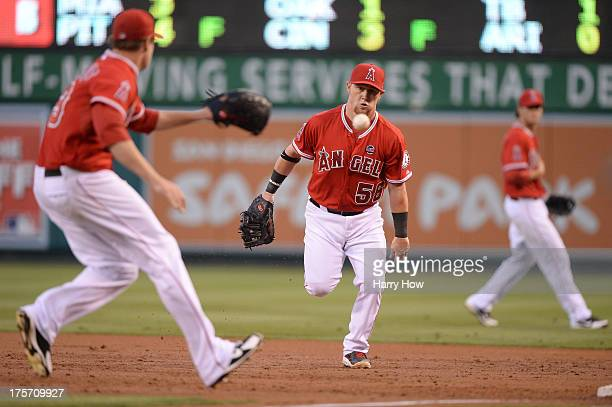 Kole Calhoun of the Los Angeles Angels makes a play to Garrett Richards for an out of David Murphy of the Texas Rangers during the second inning at...