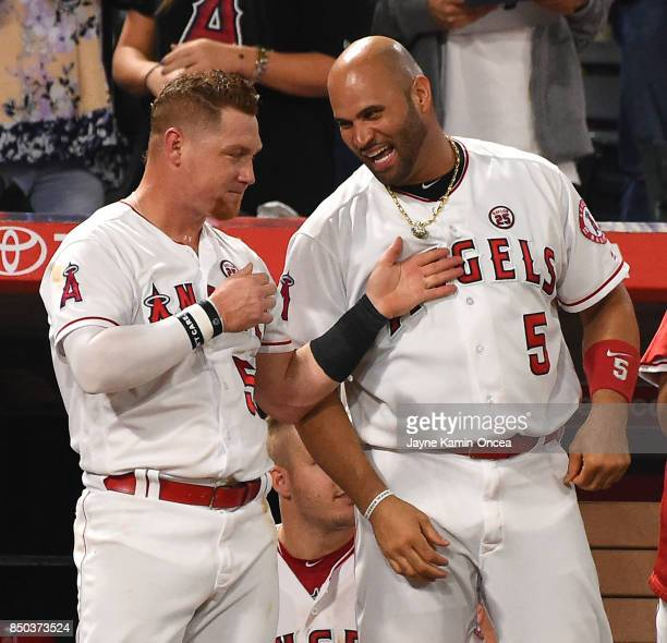 Kole Calhoun of the Los Angeles Angels of Anaheim and Albert Pujols of the Los Angeles Angels of Anaheim stand on the dugout steps during the game...