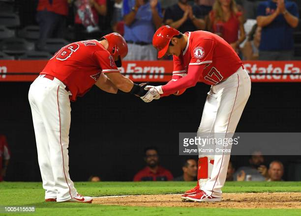Kole Calhoun of the Los Angeles Angels of Anaheim bows to Shohei Ohtani of the Los Angeles Angels of Anaheim after he hit a two run home run in the...