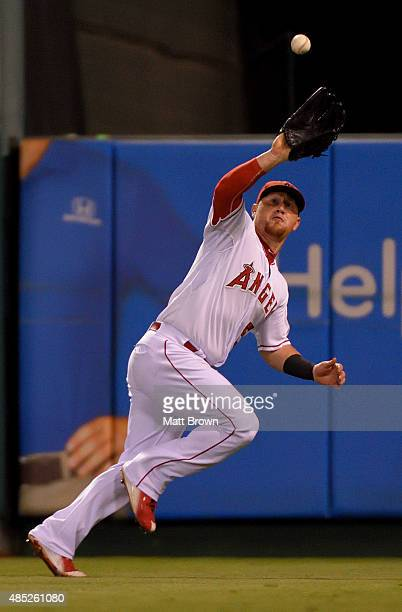 Kole Calhoun of the Los Angeles Angels of Anaheim catches a long drive by Jerry Sands of the Cleveland Indians during the twelfth inning of the game...