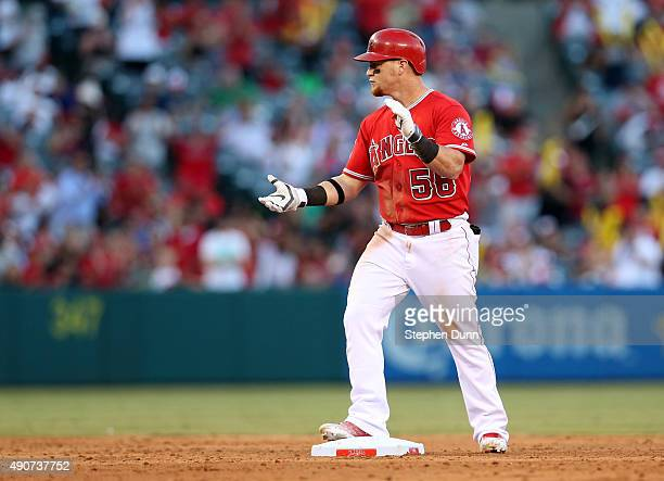 Kole Calhoun of the Los Angeles Angels of Anaheim celebrates as on second base after hitting an RBI double in the sixth inning against the Oakland...