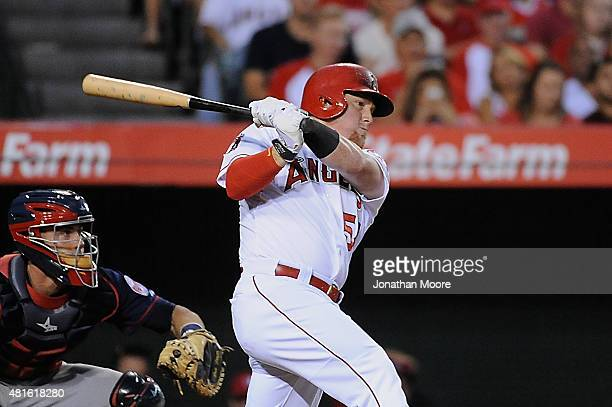 Kole Calhoun of the Los Angeles Angels of Anaheim follows through on an RBI single in the third inning during a game against the Minnesota Twins at...