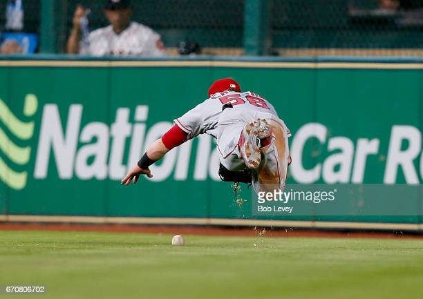 Kole Calhoun of the Los Angeles Angels of Anaheim has the ball deflect off his glove on a line drive by Alex Bregman of the Houston Astros in the...