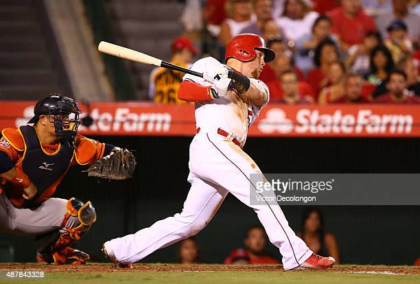 Kole Calhoun of the Los Angeles Angels of Anaheim hits a tworun rbi single to left field in the second inning during the MLB game against the Houston...