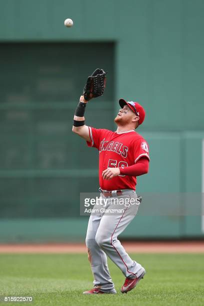 Kole Calhoun of the Los Angeles Angels of Anaheim makes a catch during a game against the Boston Red Sox at Fenway Park on June 25 2017 in Boston...