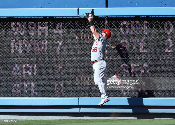 Kole Calhoun of the Los Angeles Angels of Anaheim makes the jumping catch on a fly ball to the right field wall during the first inning of the MLB...