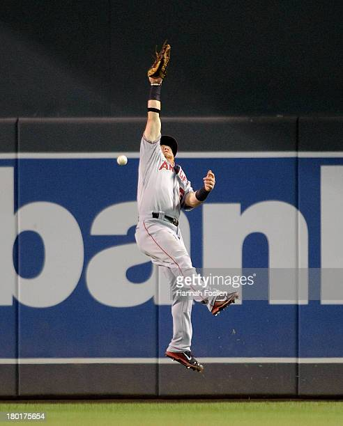 Kole Calhoun of the Los Angeles Angels of Anaheim misses the catch of the double hit by Josmil Pinto of the Minnesota Twins during the eighth inning...