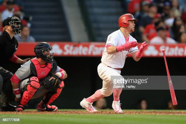 Kole Calhoun of the Los Angeles Angels of Anaheim pops out to centerfield as James McCann of the Detroit Tigers looks on during the fourth inning of...