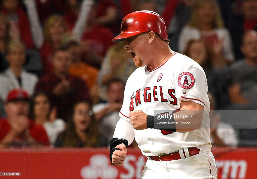 Kole Calhoun #56 of the Los Angeles Angels of Anaheim reacts after beating the throw to Brett Nicholas #6 of the Texas Rangers and scoring a run on a single by Andrelton Simmons #2 of the Los Angeles Angels of Anaheim in the fourth inning of the game against the Texas Rangers at Angel Stadium of Anaheim on September 15, 2017 in Anaheim, California.