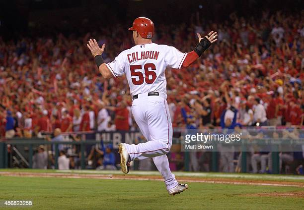 Kole Calhoun of the Los Angeles Angels of Anaheim reacts to a catch by Norichika Aoki of the Kansas City Royals in the outfield in the bottom of the...