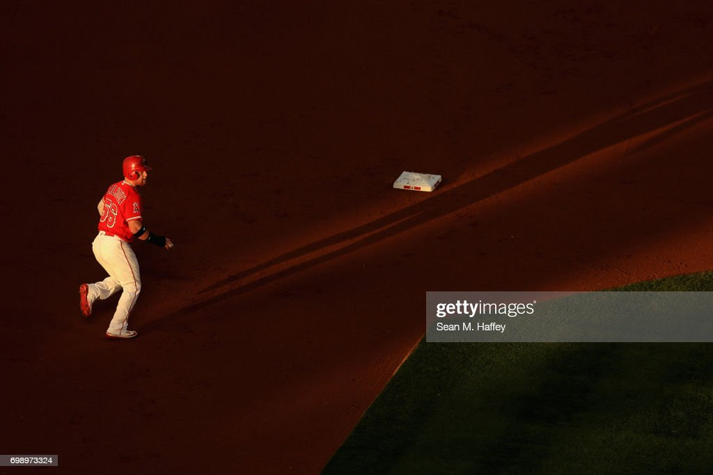 Kole Calhoun #56 of the Los Angeles Angels of Anaheim runs back to second base during a game against the Kansas City Royals at Angel Stadium of Anaheim on June 15, 2017 in Anaheim, California.