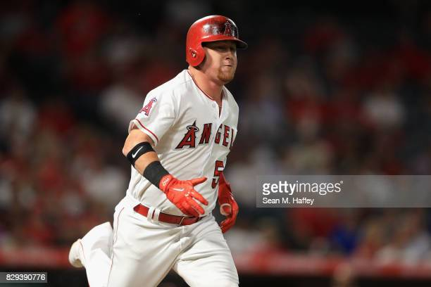 Kole Calhoun of the Los Angeles Angels of Anaheim runs to first base during a game against the Philadelphia Phillies at Angel Stadium of Anaheim on...