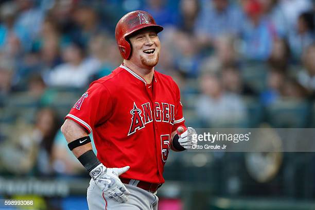 Kole Calhoun of the Los Angeles Angels of Anaheim smiles after hitting a tworun homer in the first inning against the Seattle Mariners at Safeco...