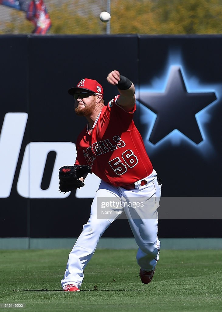 Kole Calhoun #56 of the Los Angeles Angels of Anaheim throws the ball to second base against the San Francisco Giants during the second inning at Tempe Diablo Stadium on March 12, 2016 in Tempe, Arizona.