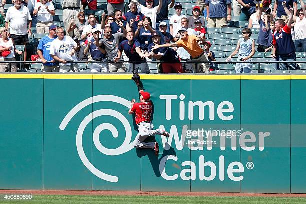 Kole Calhoun of the Los Angeles Angels of Anaheim tries but is unable to catch a walk off grand slam home run ball hit by Nick Swisher of the...