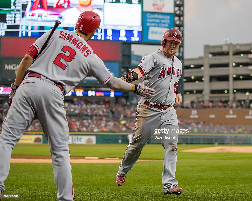 Kole Calhoun Of The Los Angeles Angels Slaps Hands With Andrelton News Photo Getty Images