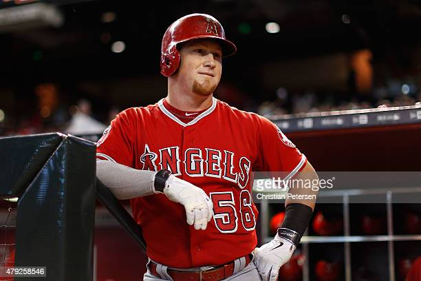 Kole Calhoun of the Los Angeles Angels watches from the dugout during the MLB game against the Arizona Diamondbacks at Chase Field on June 18 2015 in...