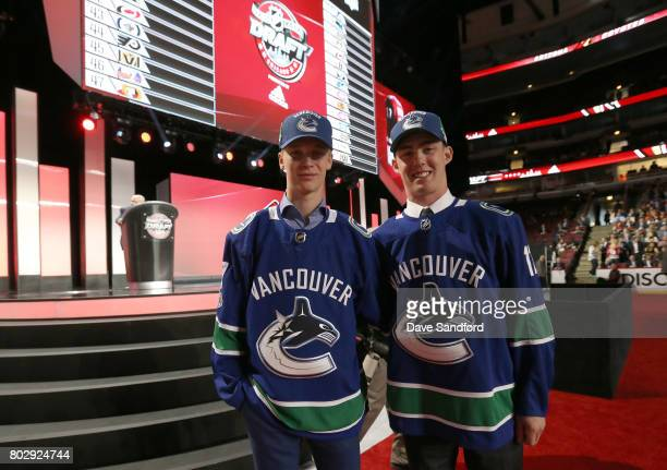 Kole Lind 33rd overall pick by the Vancouver Canucks poses with Elias Pettersson fifth overall pick during the 2017 NHL Draft at United Center on...