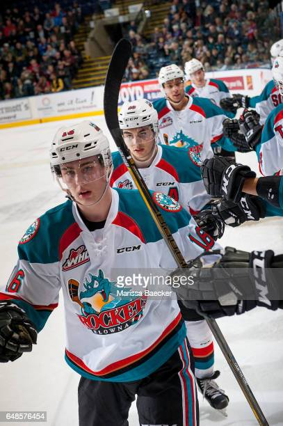Kole Lind Nick Merkley and Devante Stephens of the Kelowna Rockets skate by the bench to celebrate a goal against the Prince George Cougars on March...