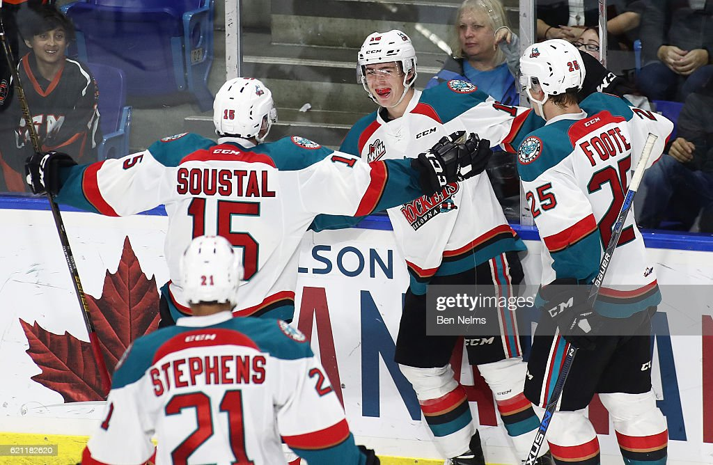 Kole Lind #16 of the Kelowna Rockets celebrates his game-winning goal agains the Vancouver Giants with teammates Tomas Soustal #15 and Cal Foote #25 during the third period of their WHL game at the Langley Events Centre on November 4, 2016 in Langley, British Columbia, Canada.