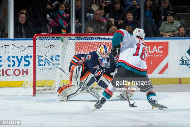 Kole Lind of the Kelowna Rockets skates with the puck during a first period penalty shot on Dylan Ferguson of the Kamloops Blazers on December 27...