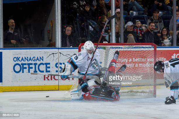 Kole Lind of the Kelowna Rockets slides into the net of Bailey Brkin of the Kootenay Ice on December 2 2017 at Prospera Place in Kelowna British...