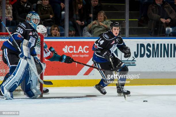 Kole Lind of the Kelowna Rockets stick checks Eric Florchuk of the Victoria Royals as he skates from behind the net with the puck at Prospera Place...