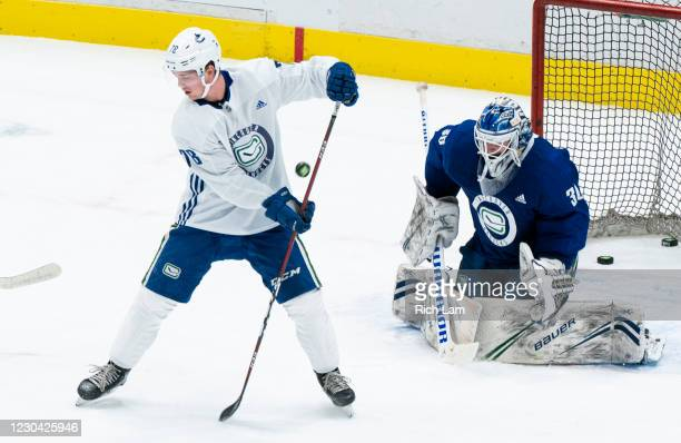 Kole Lind of the Vancouver Canucks redirects the puck on goalie Josh Teves during a drill on the first day of the Vancouver Canucks NHL Training Camp...