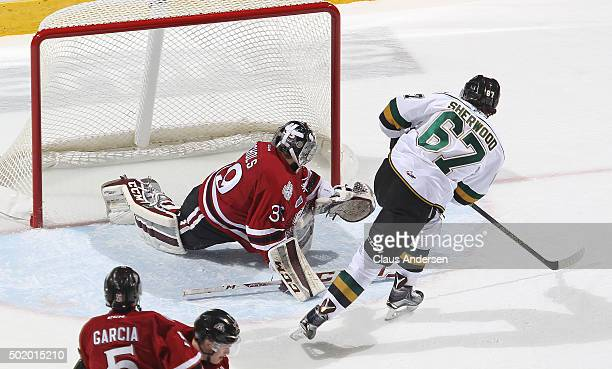 Kole Sherwood of the London Knights fires a shot past Justin Nichols of the Guelph Storm during an OHL game at Budweiser Gardens on December 18 2015...