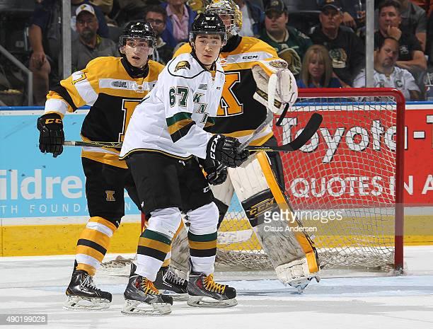 Kole Sherwood of the London Knights looks to deflect a shot against the Kingston Frontenacs during an OHL game at Budweiser Gardens on September 26...