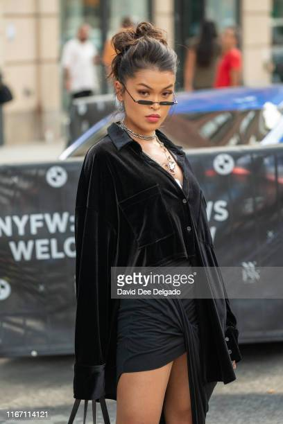 Koleen Diaz is seen wearing a black button down shirt, black skirt, and a Prada bag during New York Fashion Week at Spring Studios on September 9,...