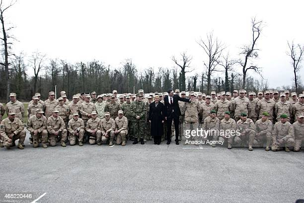 Kolinda GrabarKitarovic President of Croatia attends a ceremony held for 102 soldiers who were sent to Afghanistan from Croatia Albania Montenegro...
