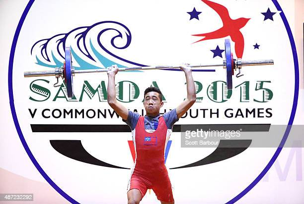 Kolisi Siilata of Samoa lifts during the Men 56kg A Weightlifting at the Tuanaimato Sports Facility on day one of the Samoa 2015 Commonwealth Youth...