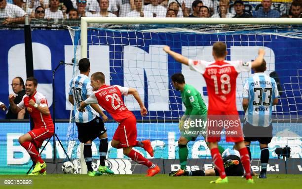 Kolja Busch of Jahn Regensburg celebrates after he scores the opening goal during the Second Bundesliga Playoff second leg match betweenTSV 1860...