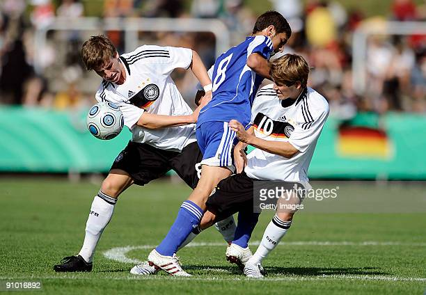 Kolja Pusch of Germany Eran Malkin of Israel and Fabian Huerzeler of Germany battle for the ball during the U17 friendly international match between...