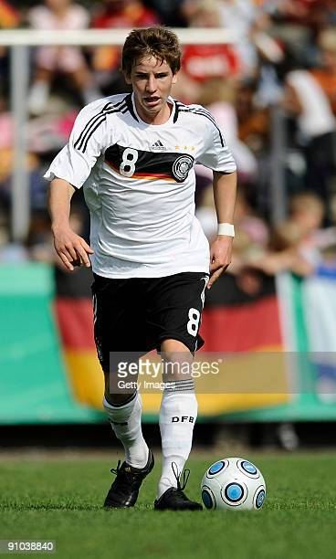 Kolja Pusch of Germany runs with the ball during the U17 friendly international match between Germany and Israel at the Belkaw Arena on September 22...